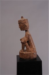 EARLY SEATED FIGURE BAMBOO STOPPER
